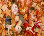 Two Brothers Playing in the Leaves